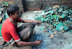 A teenager burns the Printed Circuit Boards